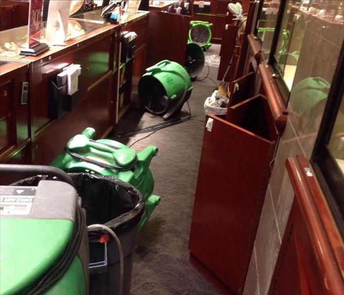 Water Damage in Retail Building Interrupts Business: After