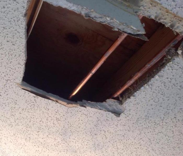 Ruptured pipe Break in Ceiling